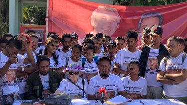 Members of East Timorese civil society group MKOTT, including Tomas Freitas (seated) and Shirley Shackleton, the widow of Balibo Five victim Greg Shackleton, at a protest on Wednesday.