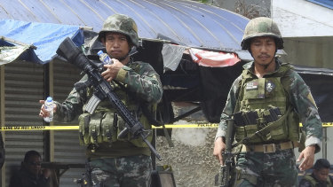 Soldiers at the scene after two bombs exploded outside a Roman Catholic cathedral in Jolo, the capital of Sulu province in southern Philippines on January 27.
