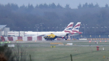 A police helicopter flies over Gatwick Airport on Thursday. Police played cat and mouse with the drone.