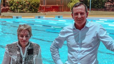 Regional Development Minister Alannah MacTiernan and Premier Mark McGowan cool off at the Kununurra pool.