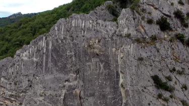 """The Benito Mussolini """"Dux"""" carving on a cliff above Villa Santa Maria, Abruzzo, Italy."""
