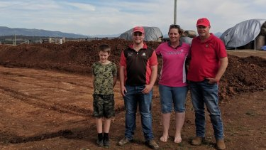 Despite building a house within 50 metres of power line, the Hill family (Cash, Ryan, Leah and Andy, left to right) near Scone in NSW opted to go off the grid altogether.