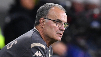 Marcelo Bielsa puts his hand up to coach Socceroos