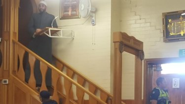 A police officer guards a door at a mosque in Melbourne on Friday afternoon.