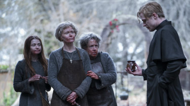 Jessica Barden as Sister Carla (left), Essie Davis (Sister Iphigenia) and Ann Dowd (Sister Margarita) confront Sam Reid (Father Ignatius) when he arrives unexpectedly at the convent.