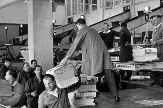 Newspapers are loaded from the presses at the Sydney Morning Herald, Broadway building in Jones Street, Ultimo in 1966.