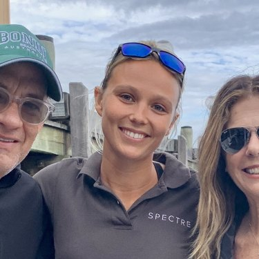 Tom Hanks and Rita Wilson with Elodie Dalgleish from Sydney Harbour Boat Tours. The Hollywood couple's COVID-19 diagnosis shut the family business down.