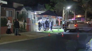 An SES tent was set up outside the Mill Park home on Wednesday night.