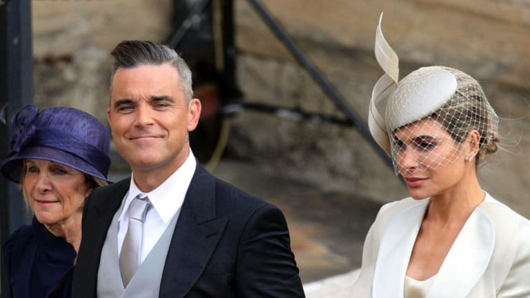 Robbie Williams, Ayda Field and Gwen Field, left, arrive for the wedding.