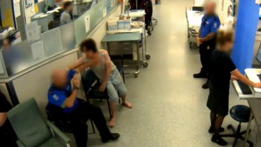 CCTV shows a security guard being punched at the Royal Brisbane and Women's hospital in 2017.