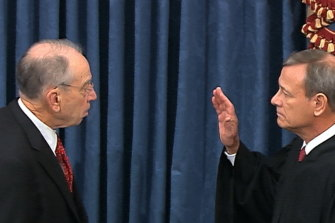 President Pro Tempore of the Senate Senator Chuck Grassley swears in Supreme Court Chief Justice John Roberts as the presiding officer for the impeachment trial of President Donald Trump.
