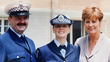 Lauren Callaway as an academy graduate with  her parents Liz and  sergeant John Callaway.