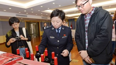 Bottles of counterfeit wine being sold on China's site, Alibaba.