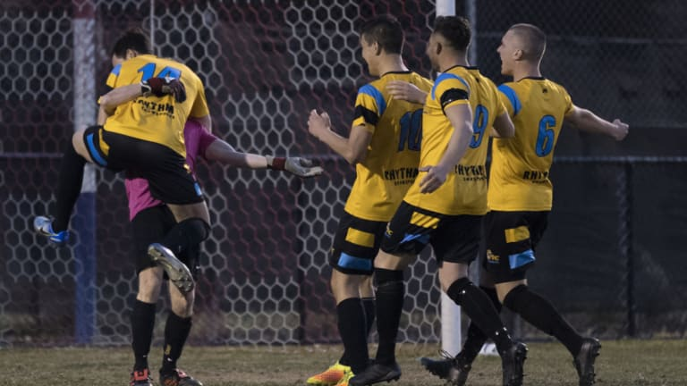 The Tigers celebrate with Cody Nash after saving the match-winning penalty.