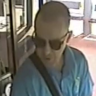 Police have released images of a man after a bus driver was punched in the face at Broadbeach on the Gold Coast.