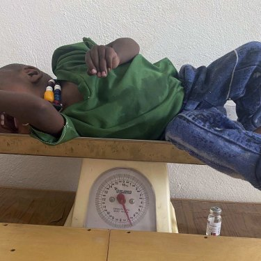 Amanuel Berhanu is weighed after being identified as severely malnourished, in the Wajirat district of the Tigray region of northern Ethiopia on Monday.
