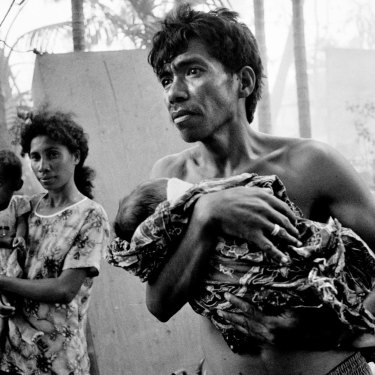 East Timorese return to the burnt out remains of their homes only to find rogue elements with the departing Indonesian Military burning nearby buildings.