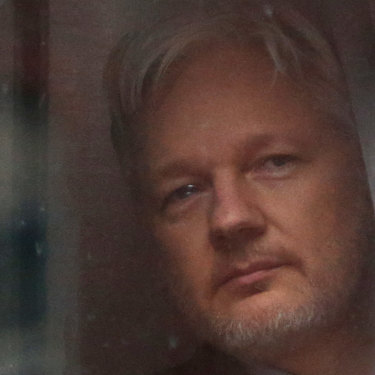 Julian Assange looks out a window of the Ecuadorian embassy in London, where he stayed for nearly seven years.