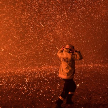 Firefighters run for safety as the Green Wattle Creek fire explodes into a sudden ember storm in Orangeville in December 2019, as captured in this award-winning photo by Nick Moir.