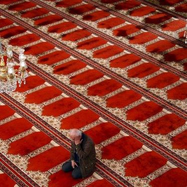 A Muslim worshipper during Ramadan in the Gallipoli Mosque in Auburn, Sydney.