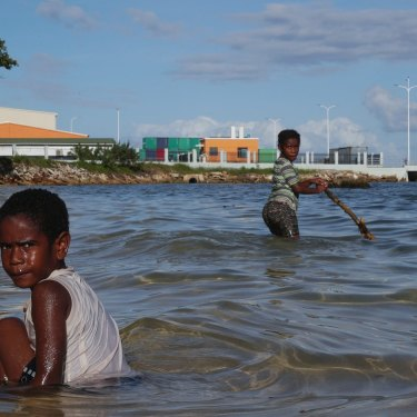 Children play near the new China-funded wharf in Luganville, Vanuatu.