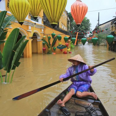 Nguyen Thi Vui in her boat in the flooded streets of Hoi An, Vietnam, in November 2017.