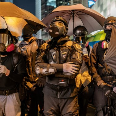 Protesters form a front line during a stand-off with police in December 2019.