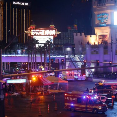 Police and medical workers block off an intersection after the mass shooting at a Las Vegas concert.