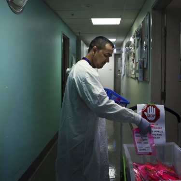 Sanjay Adhikari delivers samples that are to be tested for coronavirus at the Prince of Wales Hospital.