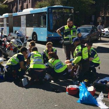 Paramedics attend to Bill Springett-Kelly after his motorbike collision last year in Bondi.