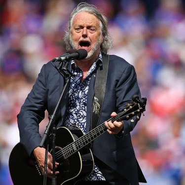 Mike Brady performs One Day in October during the 2016 AFL grand final.