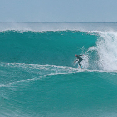 Formston heads down the front of a wave more than twice his size.