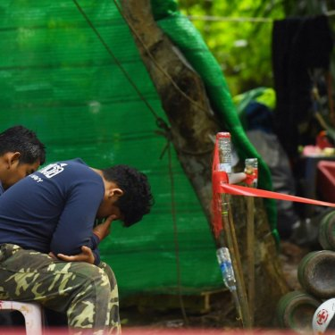 Thai navy personnel at the base camp at Tham Luang cave, the day after a former Thai navy seal died in the rescue efforts.