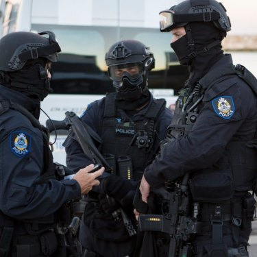 Australian Border Force and police officers conduct a drug raid last year.