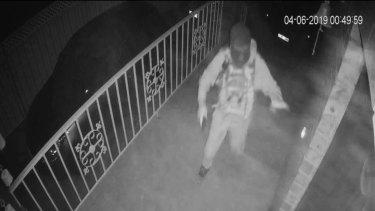 The gunman shoots at the front door.