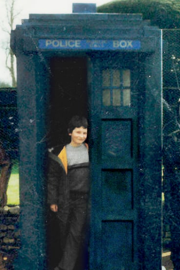 An unearthly child: Australian screenwriter Pete McTighe, aged 8, with the Tardis prop at a Doctor Who exhibition.