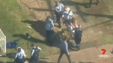 A man was stretchered from the scene as NSW police executed an interstate arrest warrant.
