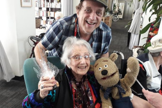 Abe Schwarz with his mum Tess at her aged care facility.