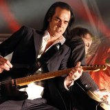 Nick Cave and Warren Ellis on stage together with their other band, Grinderman, which released two albums.