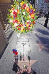 Flowers and mementoes adorned the star of Dennis Hopper on the Hollywood Walk of Fame in 2010 following his death.