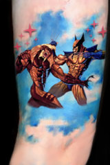 Jonathan Dick's Wolverine v Sabre-tooth tattoo.