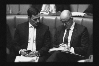 Alex Hawke (left) and Stuart Robert were among Scott Morrison's closest allies.