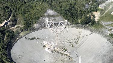 The collapsed radio telescope in Arecibo, Puerto Rico.