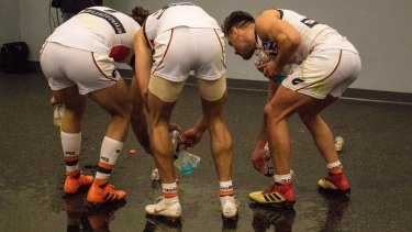 Proof nobody is bigger than the club - Phil Davis, Sam Reid and Stephen Coniglio cleaning the change rooms.