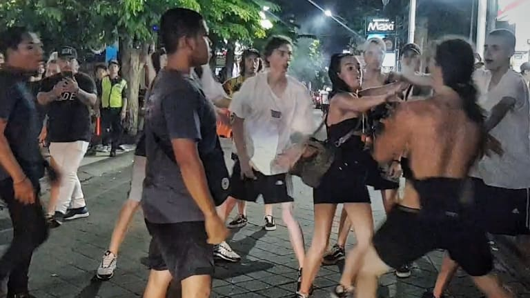 Schoolies push each other after one of the girls was hit in Bali.