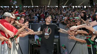 Glory, glory to South Sydney: Adam Reynolds and Rabbitohs fans celebrate their 2014 grand final triumph.
