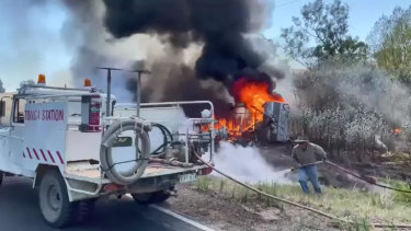 The burning car and caravan.