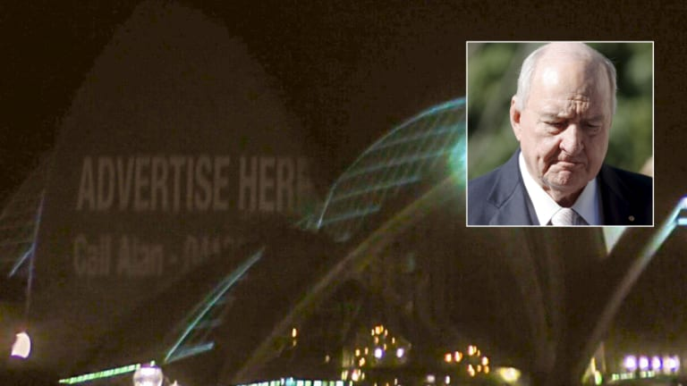 The Chaser projected an 'advertise here' sign on the Opera House on Monday night, with Alan Jones' mobile number.