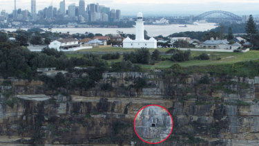 The entrance to the tunnel (circled) below the lighthouse.