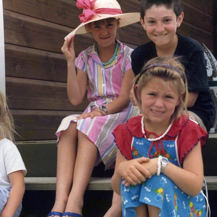 Jacinda (at front, in red and blue) with her sister Louise (in hat) and cousins Demelza and Aaron in 1987.